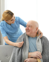 caregiver looking at the senior man