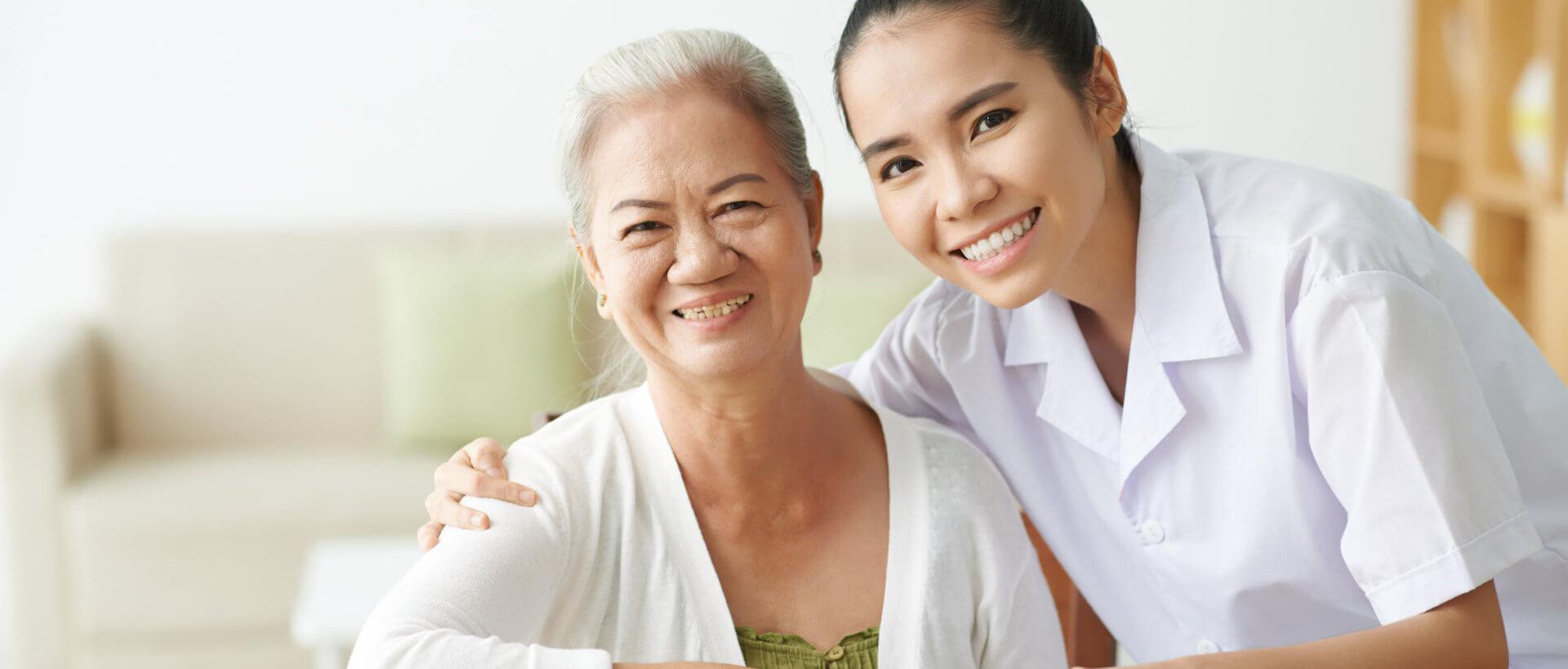 caregiver holding senior woman